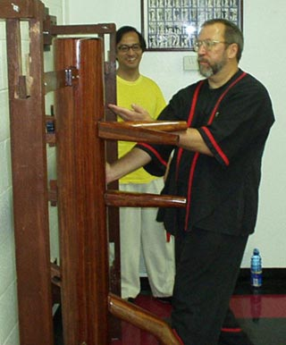 Photo - Sifu Mike Adams receives advanced WingTsun (wing tsun, wing chun, ving tsun) Kung Fu training on the wooden dummy from Great Grandmaster Leung Ting