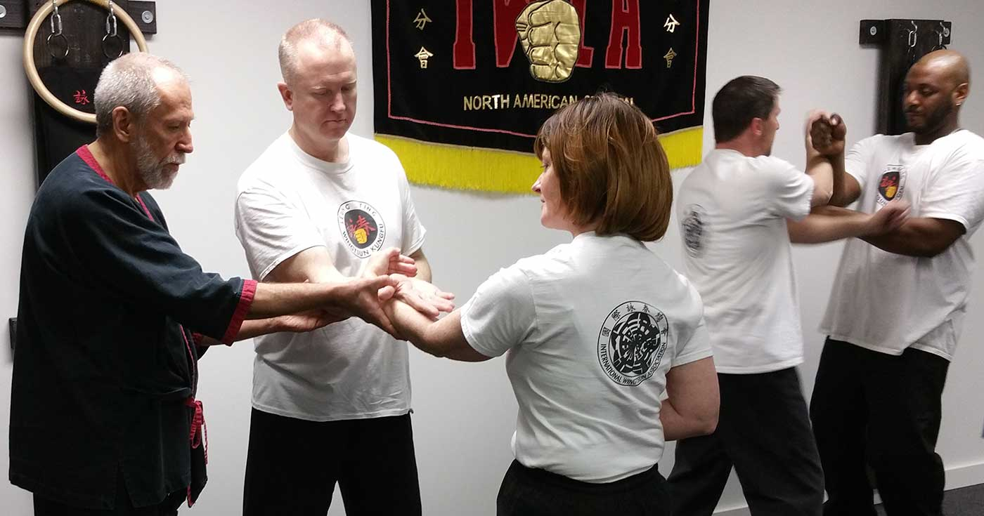 Photo: Master Mike Adams correcting students at our new Peoria, Illinois school location, Authentic Wing Tsun of Peoria