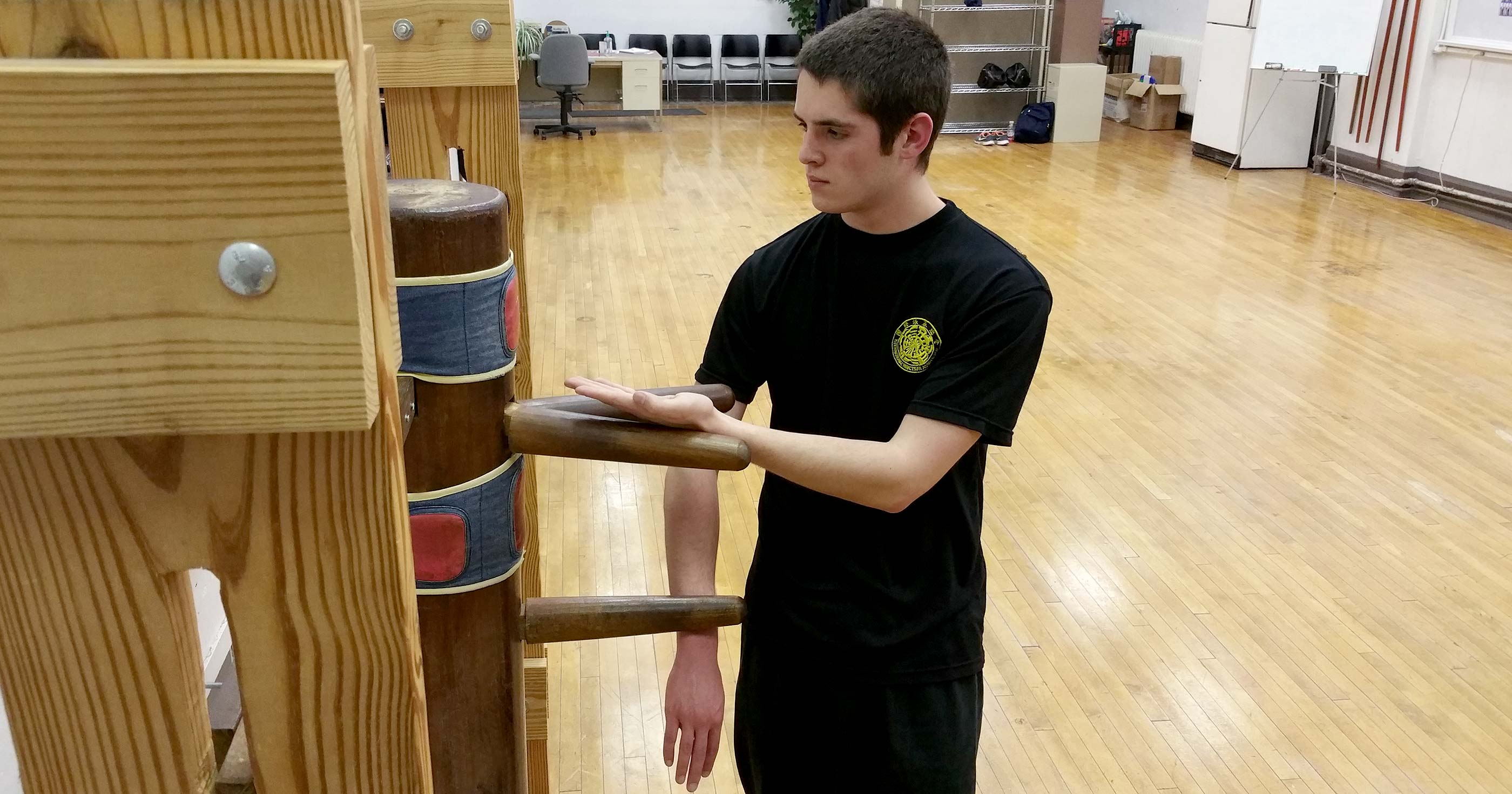 Photo: Sifu Hunter Watts training on the Wing Tsun kung fu wooden dummy