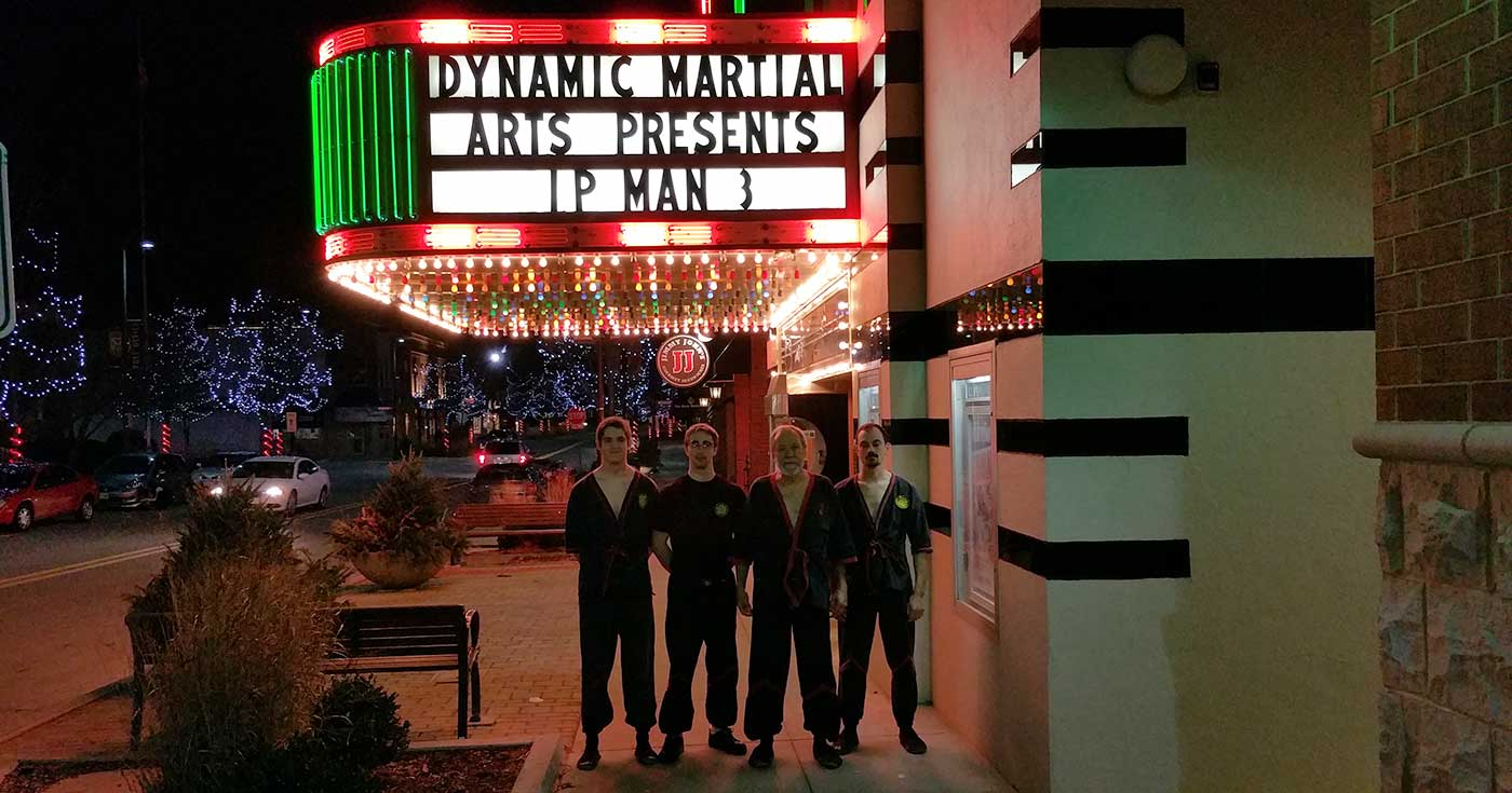 Photo: Sifu Mike Adams, Sifu Ben Stevens, Sifu Hunter Watts, and Sihing Damian Rickert under the marquis for the new Ip Man 3 movie, sponsored by Dynamic Martial Arts of Bloomington-Normal