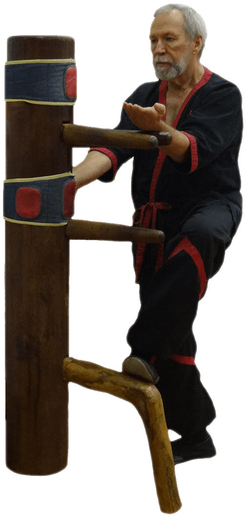 Master Mike Adams of Dynamic Martial Arts practicing Wing Tsun Kung Fu on a wooden dummy