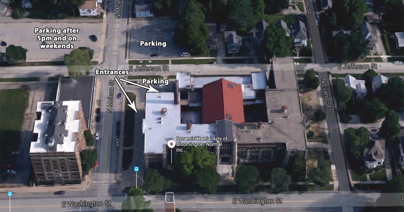 Aerial view: Building entrances and parking for Dynamic Martial Arts of Bloomington-Normal