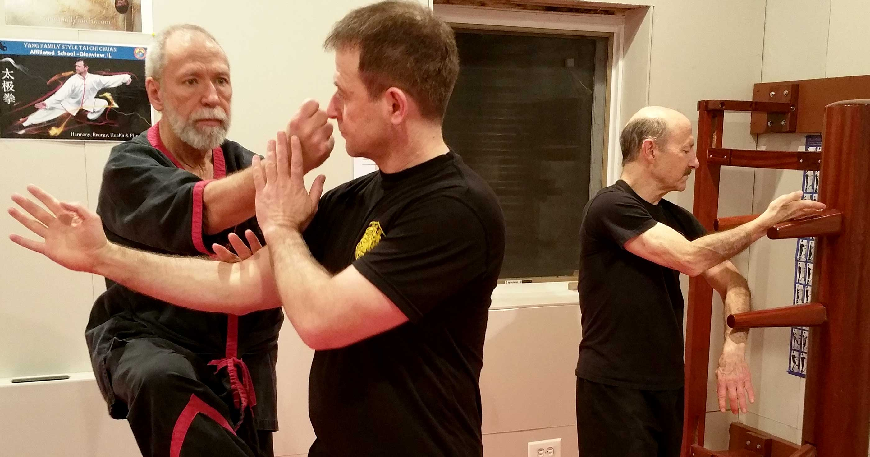 Photo: Master Mike Adams, Sifu Guerman Atanassov, and Sifu Brian Carter training WingTsun at Sifu Atanassov's home kwoon (school).