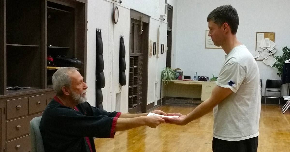 Photo: Steve McAnarney being promoted to 9th Student Grade in WingTsun by Sifu Mike Adams